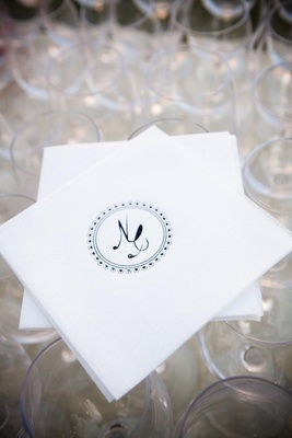 Black circle monogram on white drink napkin