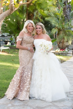 Mother of bride in off the shoulder Carolina Herrera gown
