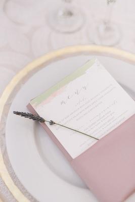 wedding reception gold rim charger plate pink linen napkin lavender sprig gold white menu card