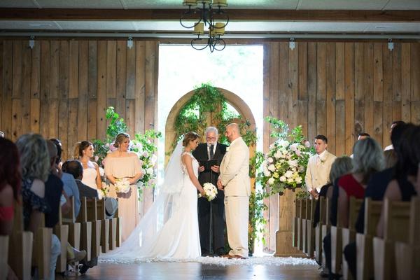 new york jets brian winters wedding, groom in tan suit, bride in pronovias wedding dress, barn