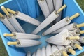 white umbrellas in blue box