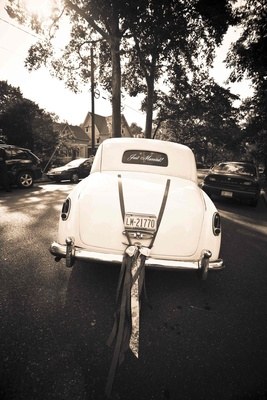 Black and white photo of old fashion wedding car