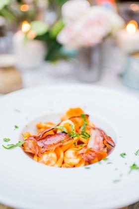 orecchiette con pancetta affumicata e panna with smoked bacon and creamy spiced tomato sauce italy