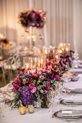 purple pink red flowers greenery mirror box taper candles low centerpiece ideas