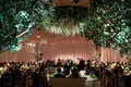 wedding reception flower chandelier tented ballroom drapery head table dance floor live band low