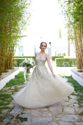 liancarlo champagne-colored wedding dress gown metallic embellishments sparkly twirling bouquet