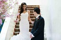 Groom looks at bride as she comes down stairs