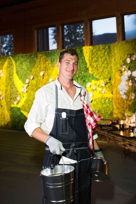 Cocktail hour oyster shucker in overalls with red white picnic blanket napkin succulent moss wall