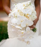 wedding bouquet white hydrangea rose and phalaenopsis orchid mermaid wedding dress veil cascading