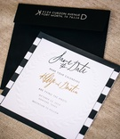 Letterpress leaf motif on card with black envelope