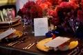 Capri wedding table name on purple table card