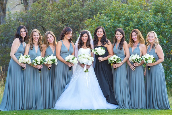 Bride in Carolina Herrera wedding dress with bridesmaids in long blue BHLDN bridesmaid dresses