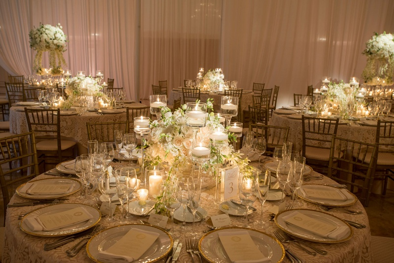 Wedding reception round table low centerpiece candles and white flowers