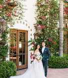wedding portrait at hummingbird nest ranch bougainvillea greenery off shoulder ball gown dress