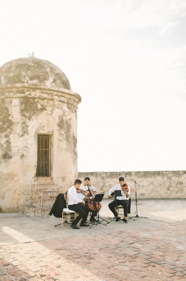 wedding ceremony in colombia at old site buildings with musicians viola violin cello music