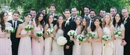 bridesmaids in mismatched nude and blush bridesmaid dresses, groomsmen in mismatched suits