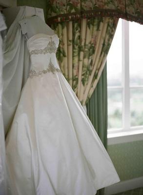 Wedding dress hanging in bridal suite