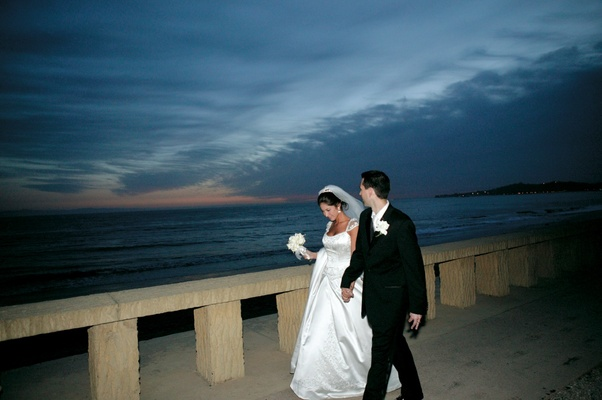 Newlyweds walking outside with ocean view