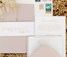 Wedding invitation suite in pink and gold with custom stamps