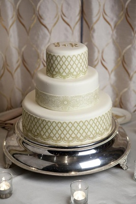 Three layer wedding cake with gold initials