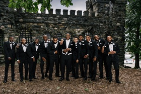 groom in long tail tuxedo white bow tie with bridal party groomsmen in tuxedos tux