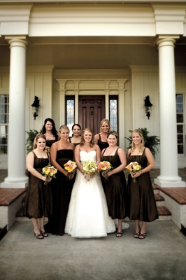 Bride in a Vera Wang gown with bridesmaids in brown Vera Wang dresses