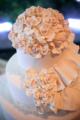 Camellia flowers on light pink wedding cake