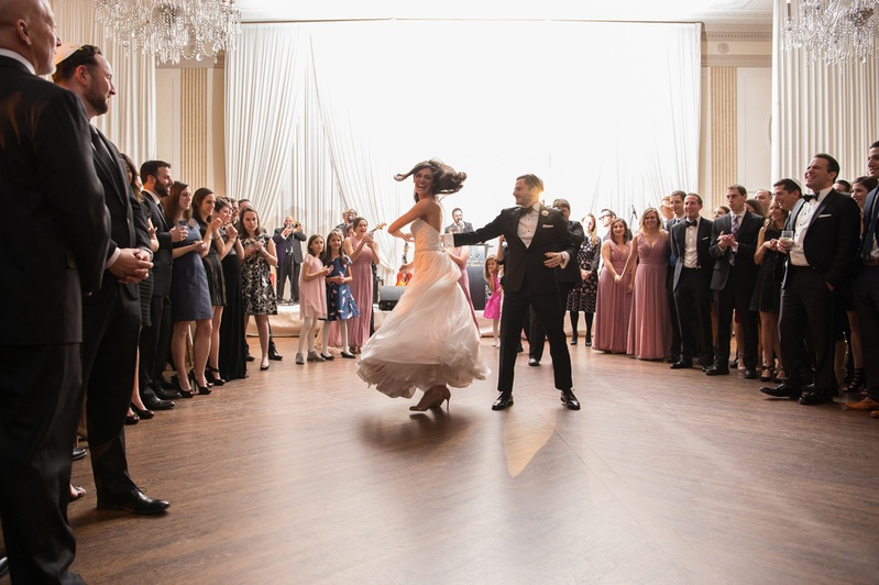 bride in essence of australia wedding dress, groom in bonobos tux, twirl on dance floor