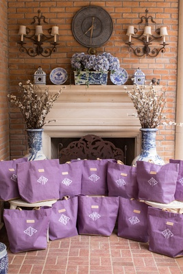 wedding favor welcome bags purple tote bag with white monogram fireplace blue white vase branches