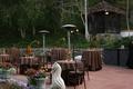 Hacienda outdoor wedding reception with brown decorations
