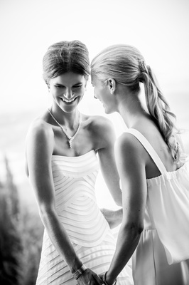 Black and white photo of bride in a Vera Wang gown with a bridesmaid