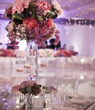 Mirrored tabletop with large pink floral arrangement