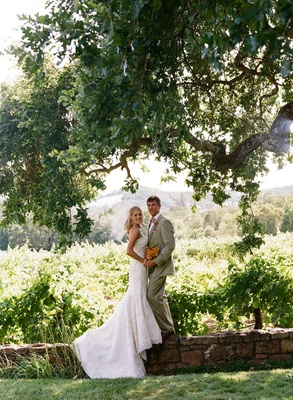 Bride and groom portrait in wine country