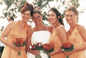 Orange bridesmaid dresses and orange bouquets