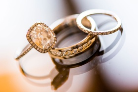 Cushion cut halo engagement ring with pave wedding bands