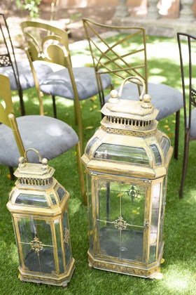 1920s inspired styled shoot antique gold lanterns art deco marking aisle