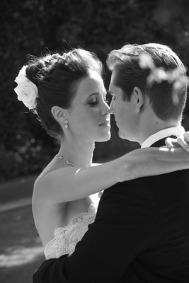 Black and white photo of bride and groom about to kiss