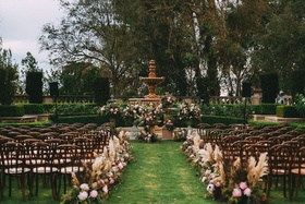 Stephanie Perez and Brandon Hampton wedding ceremony outdoor at greystone mansion flowers foliage