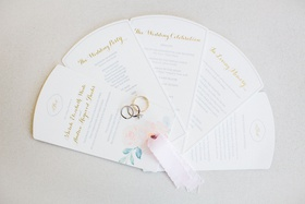 wedding ceremony program fan multiple page style wedding rings on top light pink ribbon pastel