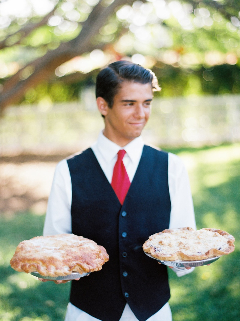 Wedding catering server holding Thyme in the Ranch pies at outdoor wedding