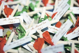 seating cards tied to starfish with orange and green ribbon