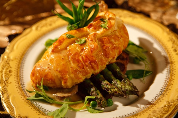 Stuffed breast of chicken in puff pastry with wild mushrooms and stones grainy mustard sauce.