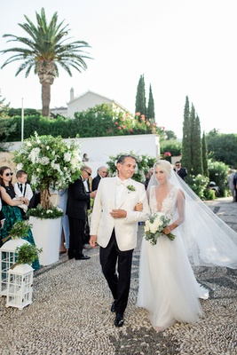 bride in francesca miranda wedding dress with butterfly appliques and plunging neckline with father