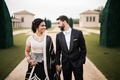 black and white sari, groom in tuxedo, south asian wedding, bride and groom holding hands