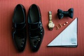 Groom's day of wedding accessories black Gucci shoes and satin bow tie tom ford pocket square gold