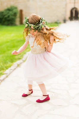 wedding flower girl destination wedding in italy child in pink gold dress with greenery flower crown