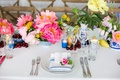 rehearsal dinner inspiration, rehearsal dinner table decorated with flowers and fruit