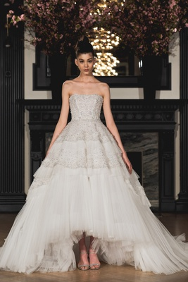 Encrusted strapless natural waist high- low ball gown with pleated ruffles, floral beaded tiers and