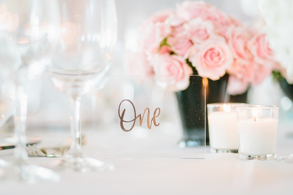 table number printed with rose gold on a small sheet of arcylic