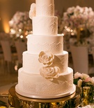 Butter End Cakery wedding cake at Beverly Hills wedding ceremony bridal gown design sugar flowers